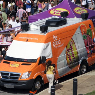 orange bus at mobile marketing event